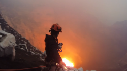 Man diving into valcano